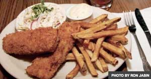 plate of fried fish, fries, slaw