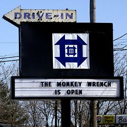 Monkey Wrench sign and logo