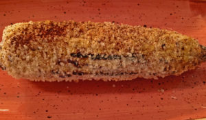 Grilled corn on the cob: Red Barn Kitchen's version of elotes with a green card.