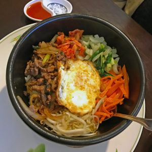 Rice Bowl's Bibimbap in a hot stone pot with Bulgogi.