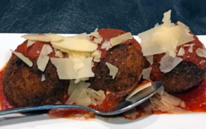 Arancini, prosciutto- and cheese-stuffed rice balls at Loui Loui's.