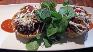 Sopes, small fried masa bowls filled with Black Angus short ribs at Guaca Mole