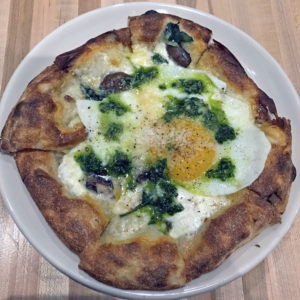 Red Hog's three-cheese pizza with spinach and fried farm egg.