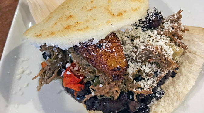 A pabellon arepa stuffed with shredded beef, an iconic Venezuelan dish at Nahyla's.
