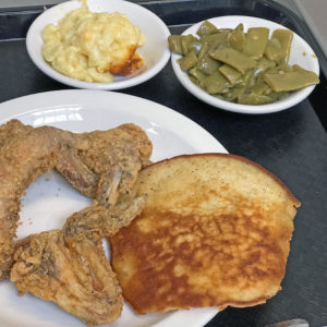 Fried chicken with sides of green beans and macaroni and cheese at Irma Dee's.