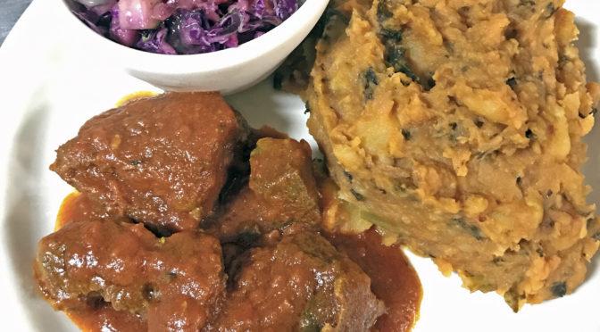Goat meat, asaro and kachumbari slaw at Funmi's.