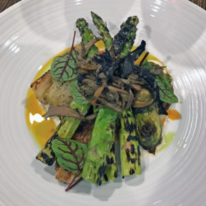 A special veggie plate on black truffle gratin at Fork & Barrel.
