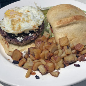 Wild Eggs' Bowling Alley burger with goat cheese and a fried egg.