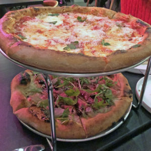 Two bar Vetti pizzas, a margherita and a country ham and arugula pie.