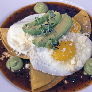 "Huevos rancheros, billed as ""our signature"" dish at Con Huevos."