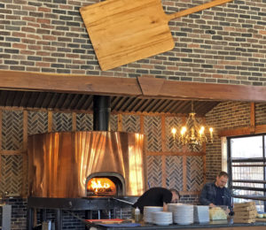 MozzaPi's bright brass pizza oven