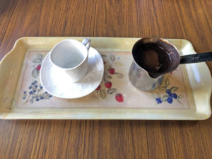 Traditional Turkish coffee service at Aladdin's Cafe, dark, rich and scented with cardamom.
