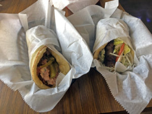 Aladdin's hearty, hand-made sandwiches: Falafel on left and a fine gyros.