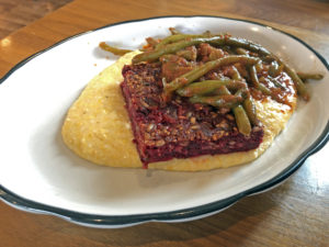 Josh's beet loaf with grits and tomato-braised green beans at Couvillion.