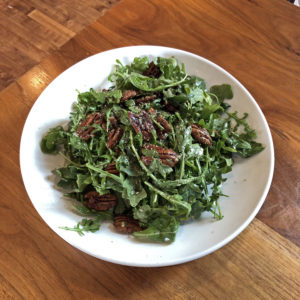 Couvillion's simple salad with arugula and candied pecans.