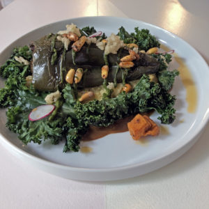 Mole poblano relleno on cheese grits and kale leaves at Naïve.