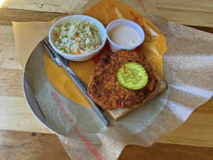 "Golden-brown vegan ""chickin"" tenders get the full, fiery Nashville hot chicken treatment at Joella's."