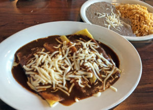 Cheesy enchiladas bathed in piquant chile sauce at Cancun Mexican Restaurant.