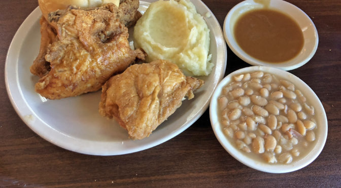 Cottage Inn's iconic fried chicken, with mashed potatoes and gravy and a side of white beans.