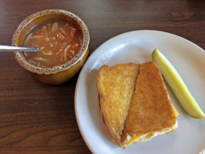 A perfect old-school grilled cheese with vegetable soup at Cottage Inn.