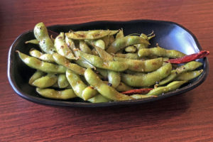 Ramen Inochi's spicy garlic edamame is fiery, aromatic and addictive.