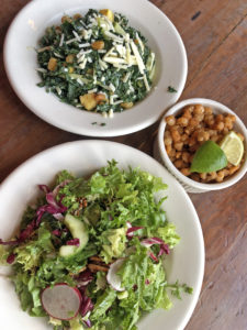 The Eagle's country green salad, kale salad and hominy corn nuts all await our attention.