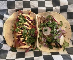 A pair of tacos – fried cod (left) and carnitas – at Taco City.
