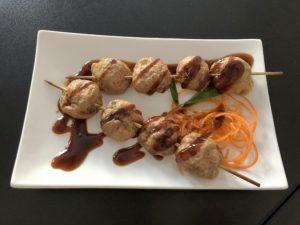 Skewered grilled meatballs, an appetizer at Eatz Vietnamese.