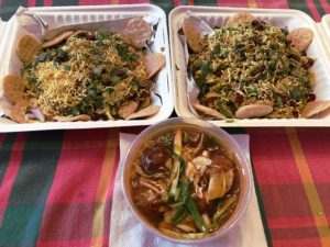 Three tempting takeouts from Shreeji Indian: On the top row, Papdi chaat and bhel puri; below,  veggie Manchurian, Chinese food made Indian-style.