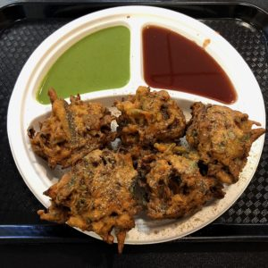Oversize pakodas, fiery onion-scented Indian fritters, at Shreeji Indian