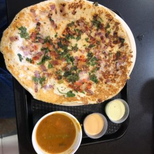 Shreeji Indian's uttapam looks a bit like a pizza, but its flavors are all Indian.