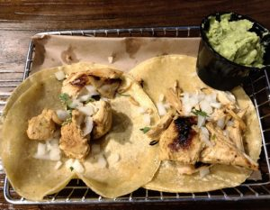 Sliced chicken adobo tacos at Down One Bourbon Bar.