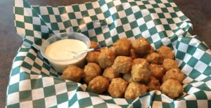 Gently seasoned and perfectly fried, Sal's jalapeño cheese balls make a fine starter.