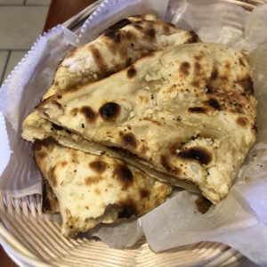 Garlic naan at Louisville Cafe India, a classic Indian wheat flatbread baked in the tandoor oven.