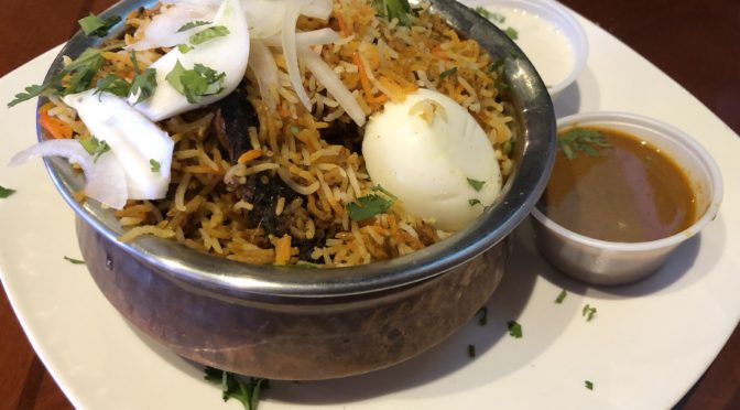 Louisville Cafe India's goat dum biryani, an iconic northern Indian rice and meat dish.