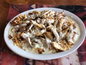 El Mariachi's arroz con pollo comes in Guanajuato style with a cheese sauce.