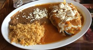 El Mariachi's chile relleno covers a green poblano pepper with rich, eggy batter.