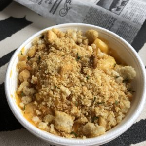 Stovetop-style macaroni and cheese at Hooked on Frankfort swims in creamy yellow cheese under a crunchy crumb topping.