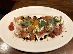 The heirloom tomato and burrata salad at Steak & Bourbon.