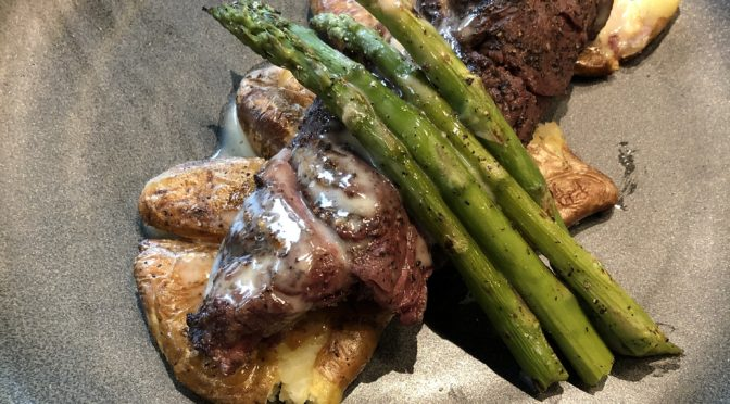 The 502 Bar & Bistro's bistro steak, a medium-rare steak served with fingerling potatoes, asparagus, and brown butter beurre blanc.