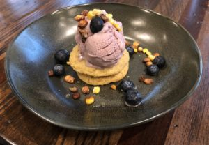 This is not your everyday cookie and ice cream, The 502 Bar & Bistro presents a generous scoop of blueberry-maple ice cream atop a pair of crisp corn cookies garnished with tiny salted corn nuts.