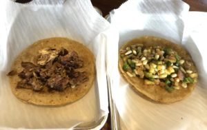 Two naked tacos – carnitas at left and veggie calabaza? – ready for a visit to La Catrina's fixings bar.