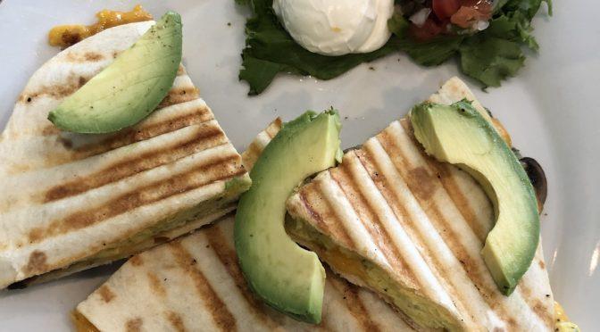 Avocado wedges top a build-your-own quesadilla at Gracious Plenty.