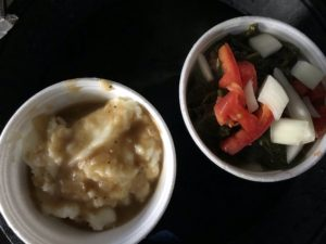 You can't go wrong with Shirley Mae's sides, like these mashed potatoes and gravy and fresh turnip greens.