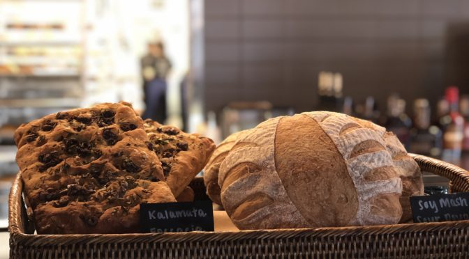 Artisan loaves in open baskets await buyers at Butchertown Grocery Bakery.