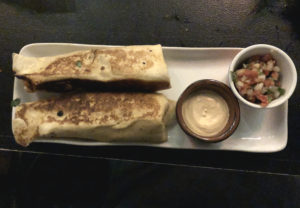 The carne asada burrito at Noche is loaded with spicy, tender grilled beef.