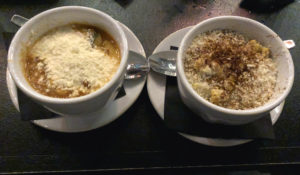 Two hearty side dishes at Noche: Corn esquites and squash calabacitas soup.