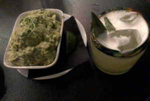 A bowl of chunky, well-made guacamole at Noche, with an intriguing sage-scented alebrije tequila cocktail.