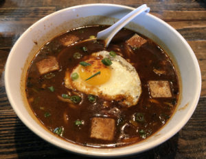 Deep, rich and dark, Diamond's big bowl of ramen gains salty umami flavor from miso and fried tofu.