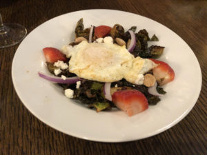 A fried egg, marcona almonds, and other good things elevate Fork & Barrel's fried brussels sprouts salad.